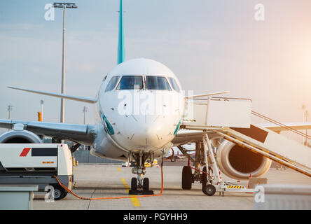 Commercial airplane beying prepared for next flight. Detail of front pilots cabine - Stock Image