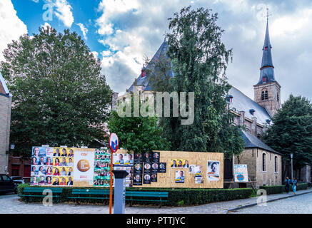 Political election posters outside St. Anne's church, Sint Annakerk, Bruges, (Brugge), Belgium - Stock Image