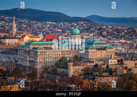 Budapest, Hungary - Aerial view of the beautiful Buda Castle Royal palace and Matthias Church in Buda district at dawn - Stock Image