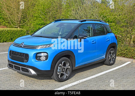 Side & front view of a new 2019 blue Citroen C3 Aircross mini SUV Flair variant with petrol engine 5 door right hand drive hatchback automobile car uk - Stock Image