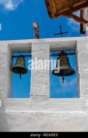 Bells inside the Monastery of Evangelitria, Skopelos, Northern Sporades Greece. - Stock Image