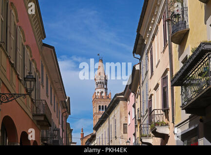 Mazzini street in the centre of Crema with the cathedral bell tower in the background, Lombardy, Italy - Stock Image