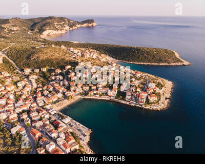 Thasos Island Skala Marion traditional village, harbour and beach as seen at sunset from above - Stock Image