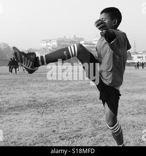 Black and white footballer - Stock Image