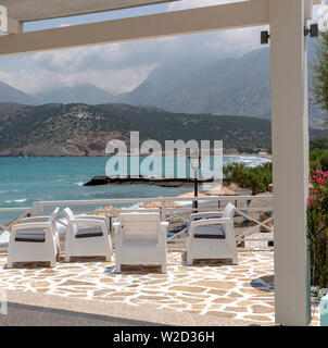 Pachia Ammos, Crete, Greece. June 2019. Restaurant bar area overlooking the beach and sea at this small resort. - Stock Image