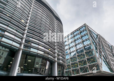 The Walbrook Building with curved solar shading (brise soleil) panels on the side wall and Cannon Street Station, City of London EC4 - Stock Image