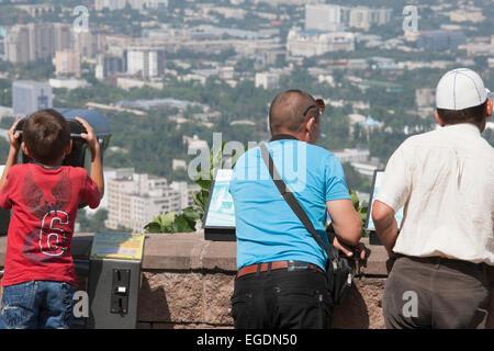 People looking at view of Almaty from Kok Tobe mountain, Almaty, Kazakhstan - Stock Image
