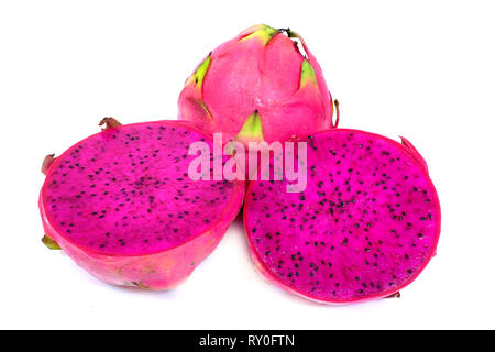 Sliced red pitahaya on a white background - Stock Image