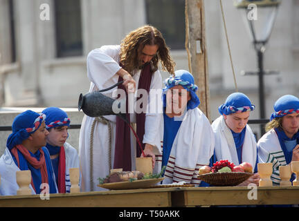 London, UK. 19th Apr, 2019. The Passion of Jesus took place in Trafalgar Square in glorious sunshine. Large crowds enjoyed a free performance with over 100 actors and volunteers from the Wintershall Players which commemorates the day Jesus is believed to have been arrested, tried and crucified. Credit: Keith Larby/Alamy Live News - Stock Image