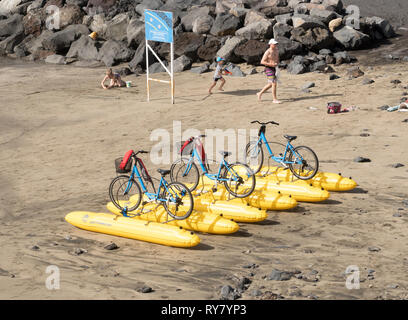 Three Shuttlebikes, bicycle propelled inflatables, on the beach in Costa Adeje, Tenerife, Canary Islands - Stock Image