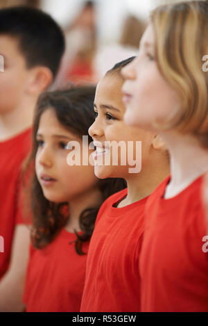Group Of Children Singing In Choir Together - Stock Image