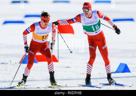Krasnoyarsk, Russia. 09th Mar, 2019. KRASNOYARSK, RUSSIA - MARCH 9, 2019: Skiers Kirill Kilivnyuk (L) and Anton Timashov of Russia during the men's 4x7, 5 men's cross-country skiing relay race at the 2019 Winter Universiade. Vladimir Smirnov/TASS Credit: ITAR-TASS News Agency/Alamy Live News - Stock Image
