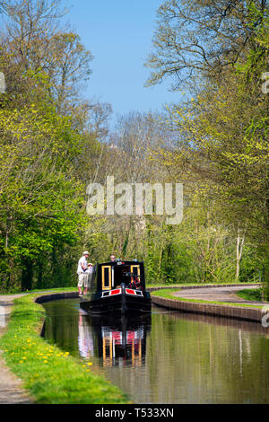 Front view of a canal boat travelling towards the camera with people on board, Pontcysyllte near Llangollen, Wales, UK. - Stock Image