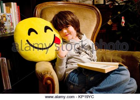 portrait of baby with the book - Stock Image