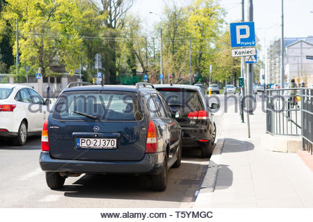 Poznan, Poland - April 18, 2019: Parked blue Opel Astra station car by a parking area in the city center. - Stock Image