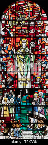 St. Wilfred commemorated in stained glass, Ripon Cathedral, UK - Stock Image