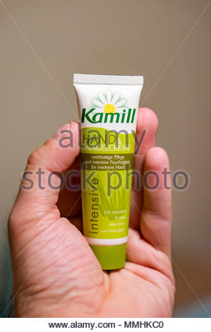 Poznan, Poland - March 23, 2018: German Kamill Intensive hand and nail cream on a hand palm - Stock Image