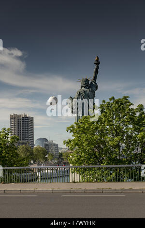 France, Paris, 2019/04: Isle of Swans, A quarter-scale replica of the Statue of Liberty, 22 metres tall, faces its larger sister in New York city. - Stock Image
