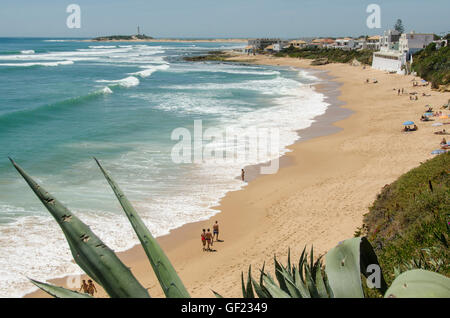 View of the beach in the small seaside town of Los Caños de Meca, in Cádiz province.  Cape Trafalgar and - Stock Image