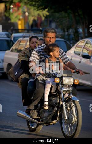 Iranian family on a motorcycle, Shiraz, Iran - Stock Image