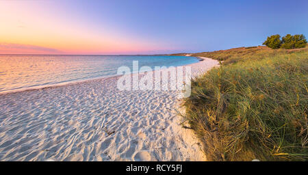 Australian beach at sunset. Coral Bay, Western Australia - Stock Image