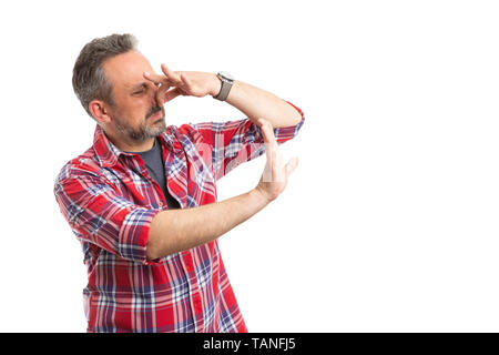 Man making stop or wait gesture with palm as holding nose because of gross smell isolated on white background - Stock Image
