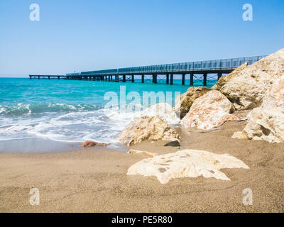 A long pier on the Mediterranean coast near the town of Polis - Stock Image