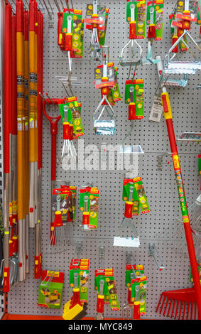 A display of distinctive red and chromium German made Wolf Garten brand gardening tools for sale in  garden centre - Stock Image