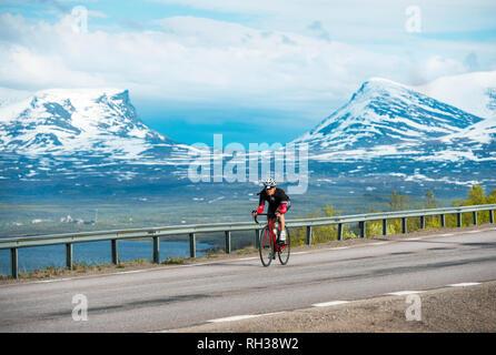 Woman cycling - Stock Image