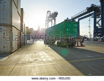 Truck with cargo container on dock - Stock Image