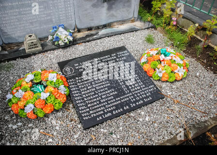 Engraved memorial stone to the 12 Irish Republican hunger strikers from 1981 at the Antrim Plot, Milltown Cemetery, Belfast, Northern Ireland - Stock Image