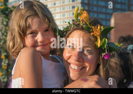 Mother and child at the Swedish Midsummer Festival held annually in Battery Park City's Wagner Park. - Stock Image