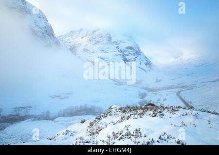 Glencoe ,Scottish Highlands the 'thee sisters covered in winter snow and cloud - Stock Image