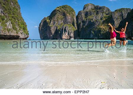 Two girls having fun at Maya Bay - Koh Phi Phi Ley island - Thailand - Stock Image