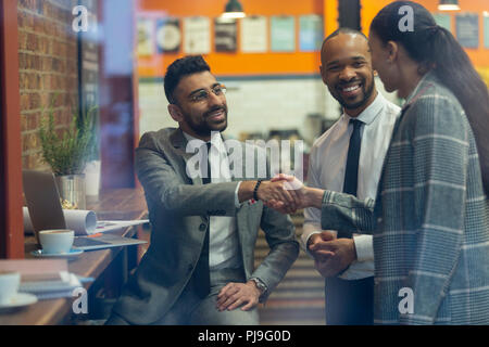 Business people handshaking in cafe - Stock Image