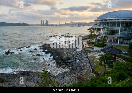 Seascape in Busan, South Korea, with APEC building in the foreground and city in the far horizon. - Stock Image
