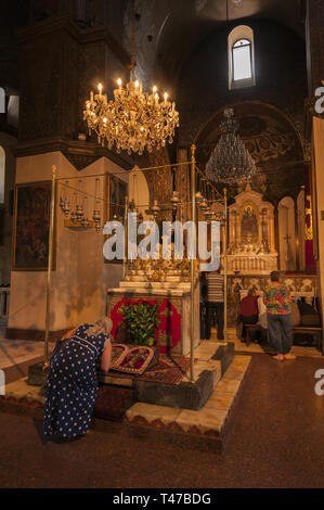 Armenia, Vagharshapat (Etchmiadzin), Etchmiadzin Holy See Cathedral interior with people, 301-303 AD, built by Armenia's patron saint Gregory the Illu - Stock Image