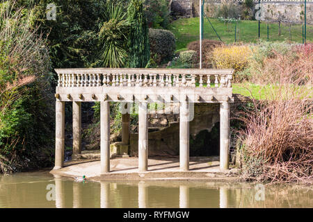 A private boat landing in a romanesque style with columns supporting a sheltering roof on the river Avon , Bradford on Avon , Wiltshire - Stock Image