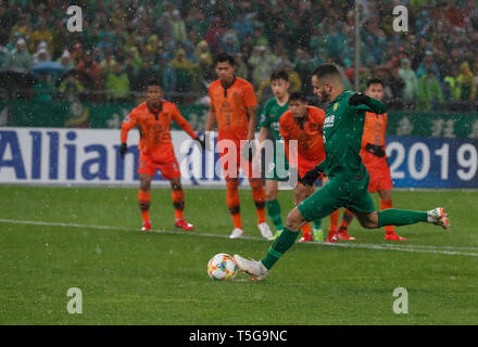 Beijing, China. 24th Apr, 2019. R. Augusto of Beijing Guoan FC shoots the penalty during the group G match between China's Beijing Guoan FC and Thailand's Buriram United at the 2019 AFC Champions League in Beijing, capital of China, April 24, 2019. Credit: Ding Xu/Xinhua/Alamy Live News - Stock Image