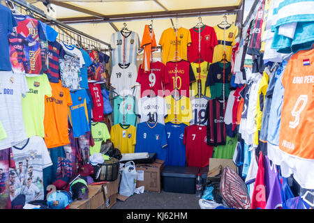 LANZAROTE, SPAIN-4th Nov 2017: Various football t-shirts and other souvenirs can be found on sale at the Marina - Stock Image