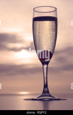Cava champagne with cherry as sunset - Stock Image