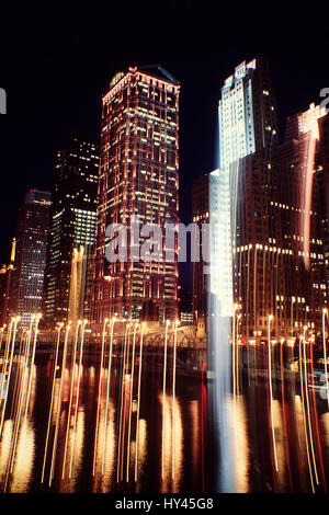 Low Angle View Of Skyscrapers Lit Up At Night - Stock Image