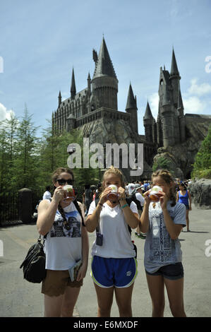 Three young Australian visitors enjoying a drink at Harry Potter World, Universal Orlando Resort, Orlando, Florida, - Stock Image