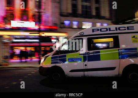 Police van attending an emergency call on Tottenham Court Road, London, England, UK - Stock Image