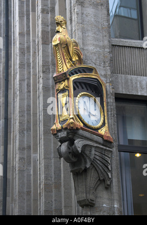 Ornate Gold Clock Outside a Building in Konigsallee Dusseldorf Germany - Stock Image