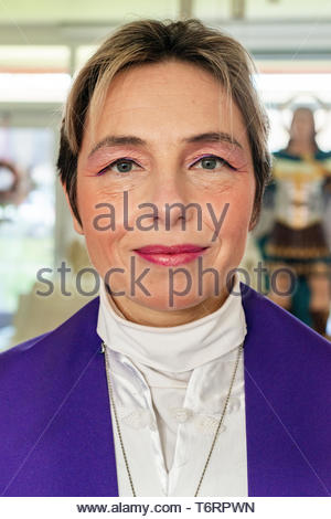 Dongen, Netherlands. Female 'Spiritual Leader', intermediate between angels and humans, preparing for a service she is going to give to a coupe of fol - Stock Image