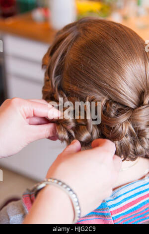 Bride,hair,hairstyle,brim,hairdresser,hairpin,hairstylist,hands,head,brown,beautiful,noble,ornate,high,Celebration,Ceremony,Marr - Stock Image