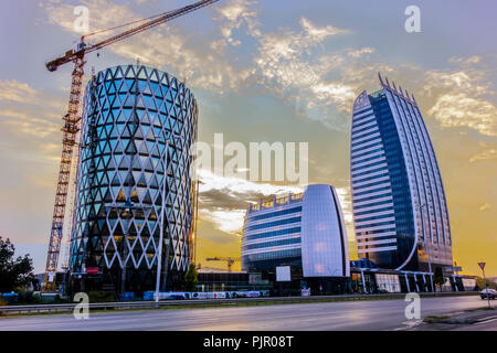 The skyscrapers and the leaning tower of Sofia. The buildings are a replica of Burj Al Arab Jumeirah in Dubai and Leaning Tower of Pisa - Stock Image