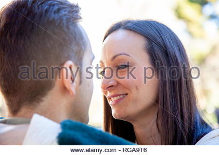A young couple in love flirts in a romantic attitude - Stock Image