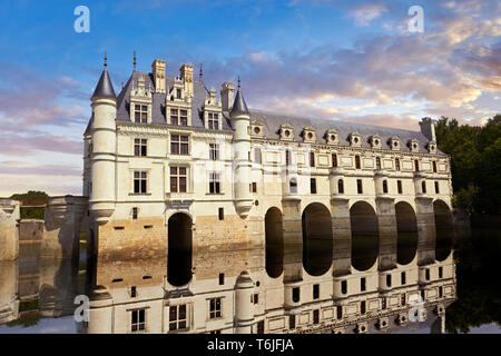 French Chateau de Chenonceau  spanning the River Cher in the the Loire Valley at sunset, Indre-et-Loire département, France - Stock Image
